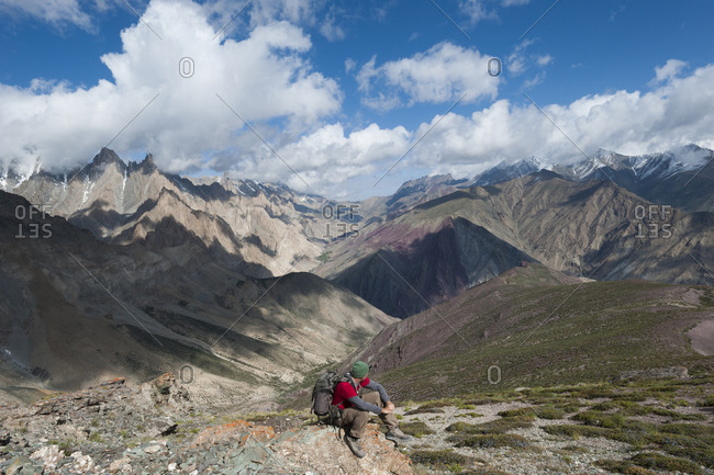 A trekker takes in the dramatic scenery from the top of the Dung Dung La on during the Hidden valleys trek