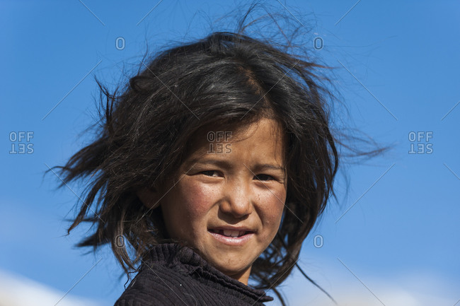 A nomad girl smiles in Ladakh smiles for the camera