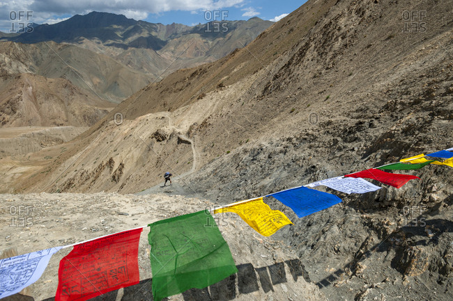 Ladakh, India - July 6, 2011: A hiker makes his way to the top of the Prinkiti La along the Hidden valleys
