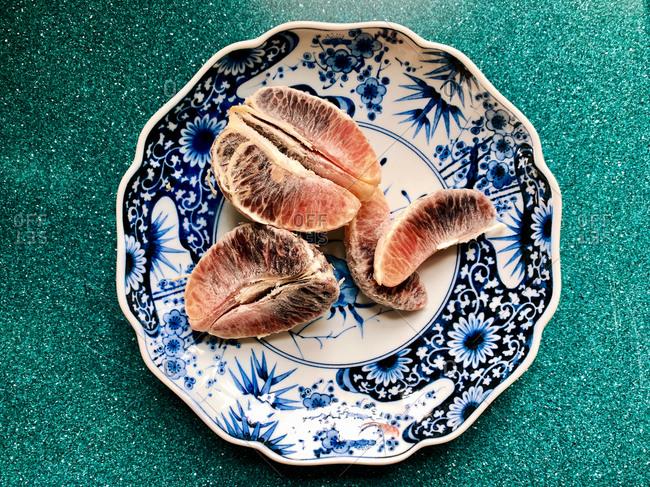 Snack of orange wedges on blue china plate