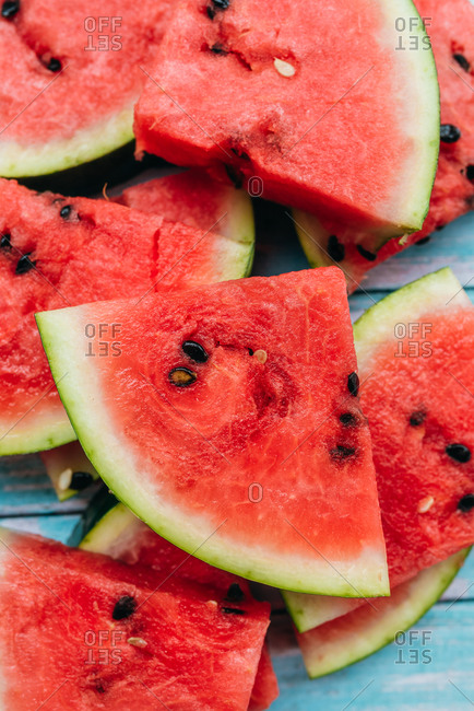 A pile of sliced watermelon triangles