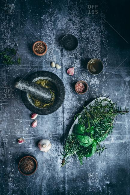 Homemade pesto basil sauce on dark background