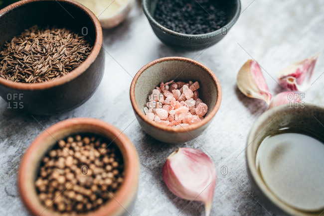 Close up of a variety of dry spices, herbs and salt