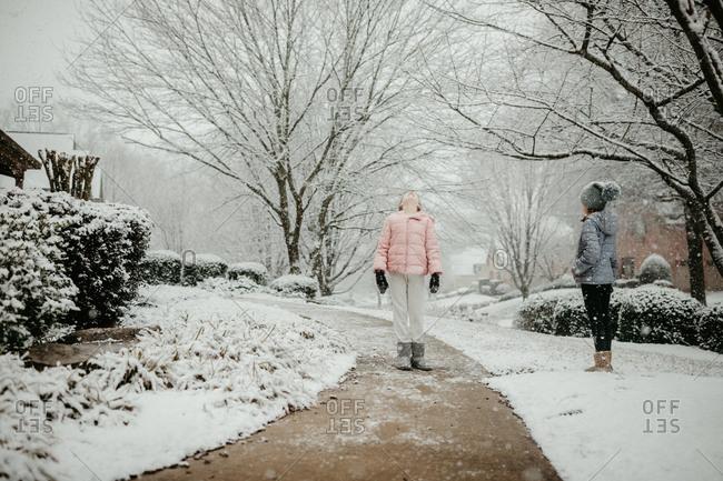 Girls enjoying a snowfall in winter