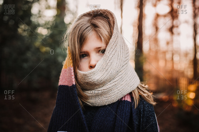Girl wearing a knit scarf over her face