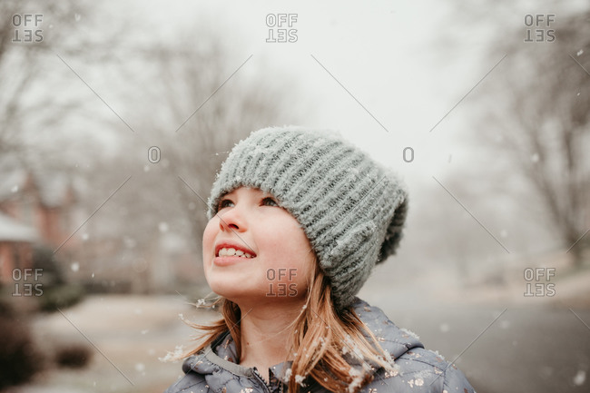 Portrait of a girl watching the snow fall around her
