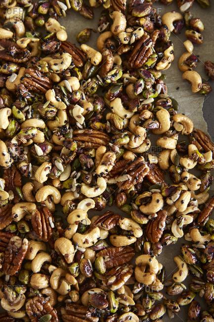 Honey roasted nuts on a baking tray