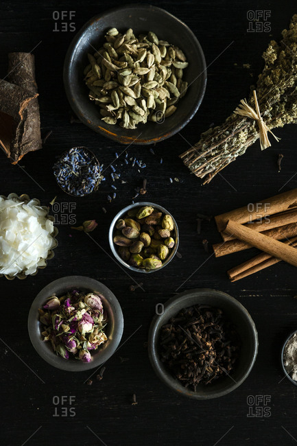 Dried flowers, herbs and spices on dark background