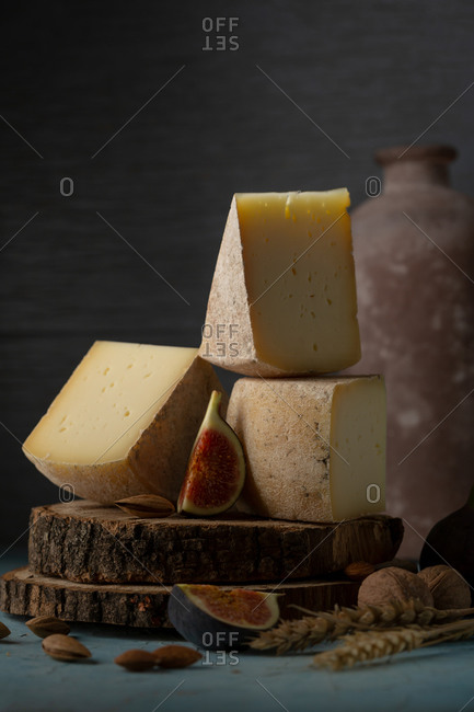 Homemade swiss cheese on old wooden disks with figs
