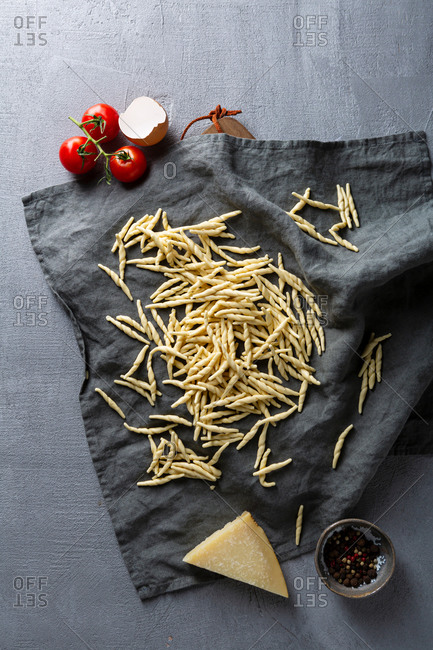 Overhead view of fresh pasta on gray background