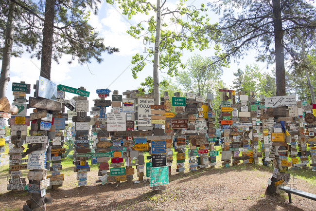 Watson Lake, Yukon, Canada - May 19, 2020: Display of various signs tourist have posted in the Signpost Forest