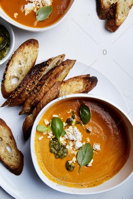 Tomato soup with toasted bruschetta and basil pesto