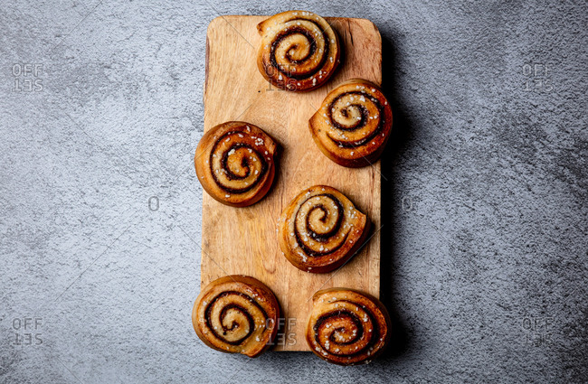 Above view of cinnamon rolls on a wooden board