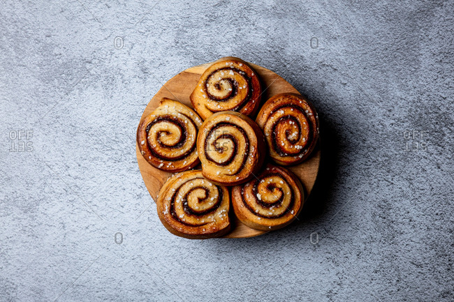Cinnamon rolls on a round wooden board