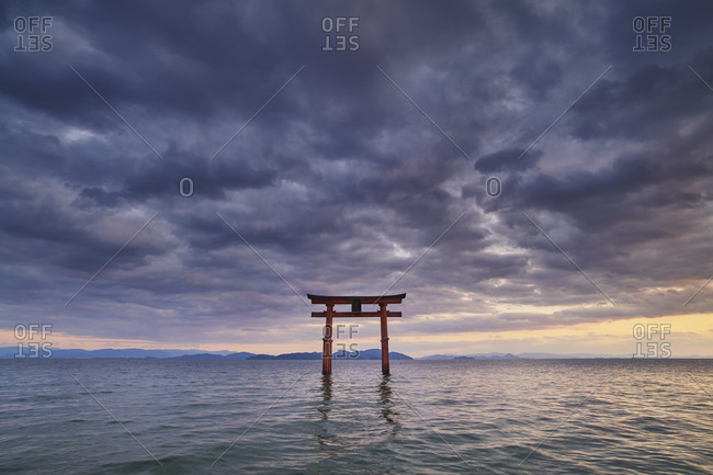 Long exposure shot of Shirahige shrine Torii gate at sunset at Lake Biwa, Shiga Prefecture, Japan