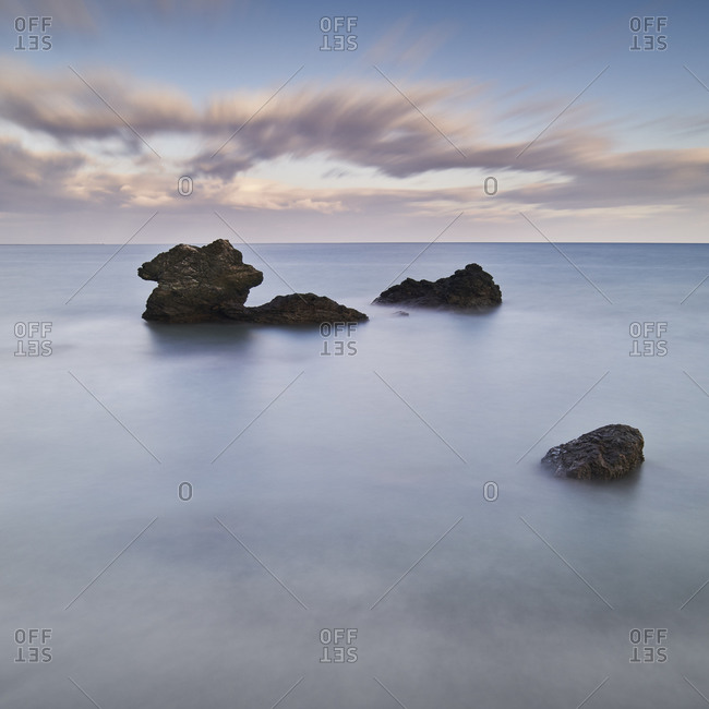 Long exposure shot of sea stacks and clouds in the morning, Mie Prefecture, Japan