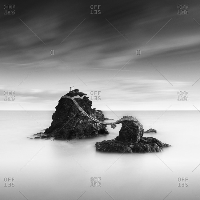 Long exposure shot of Meoto-iwa rock and clouds in the morning, Mie Prefecture, Japan