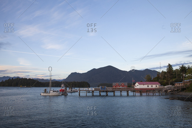 Whale watching dock on the Pacific Ocean in Tofino, British Columbia during sunset
