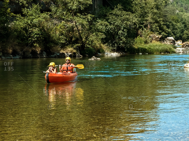 August 23, 2017: Family in canoe in a river peaceful summer day