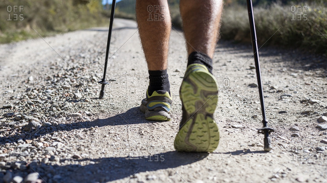 Close up of hiker legs with trekking poles