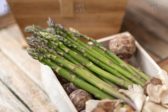 Fresh Asparagus spears in a wooden box