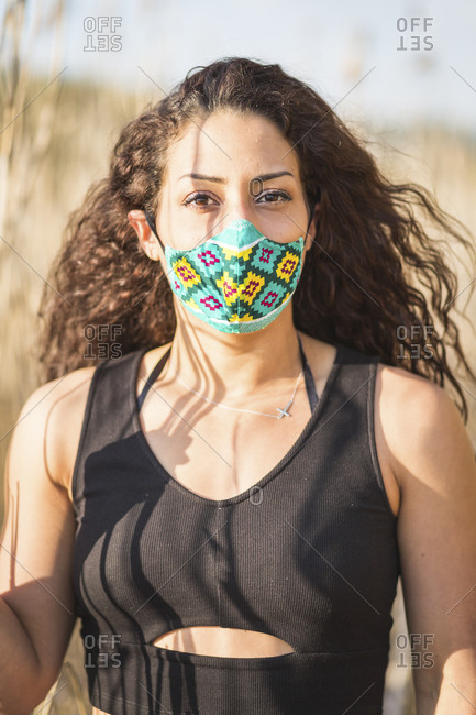 Portrait of young woman wearing self-sewn protective mask