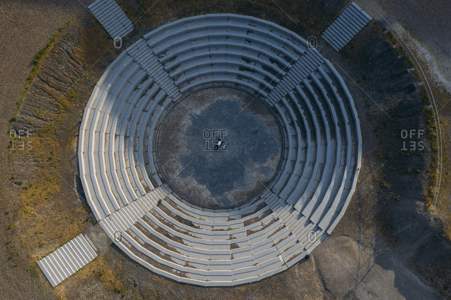 Drone view of businessman lying at BergArena amphitheater