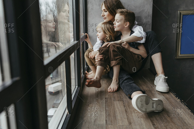 Full length of family looking through window at home