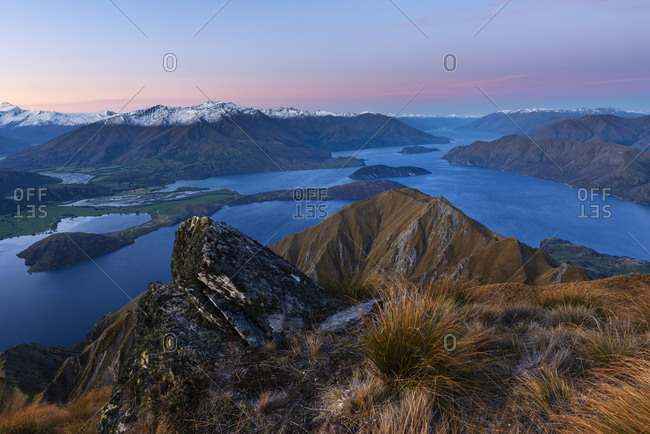 New Zealand- Otago- Scenic view of Lake Wanaka and surrounding mountains at dusk