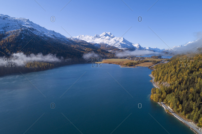 Switzerland- Canton of Grisons- Saint Moritz- Drone view of Lake Silvaplana and Lake Sils in autumn
