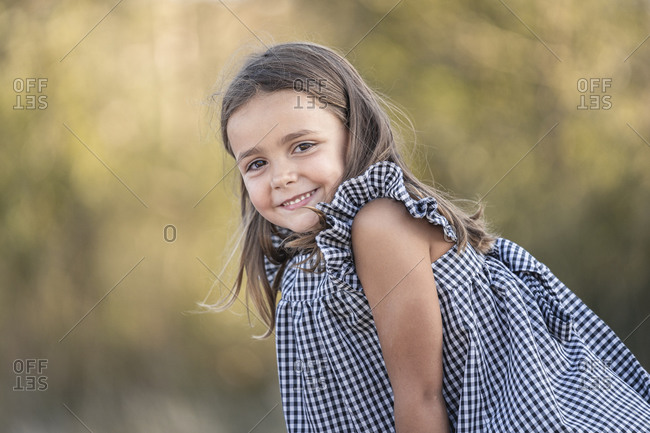 Portrait of smiling little girl in nature