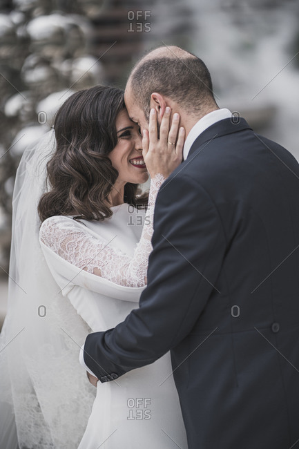 Happy bridal couple in an embrace