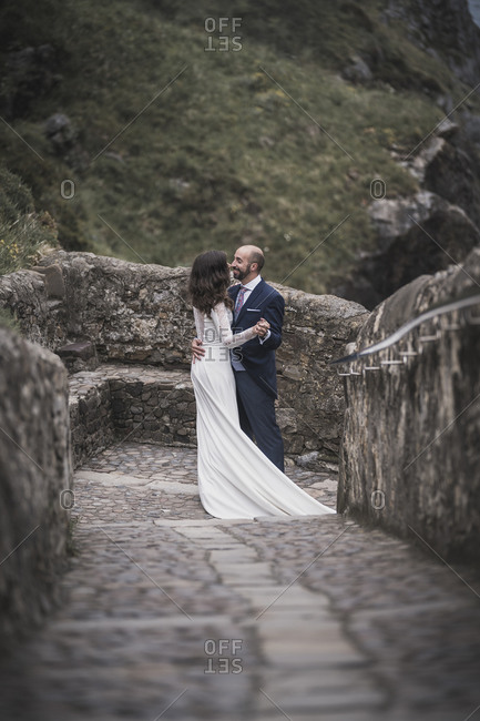 Bridal couple dancing on way- Gaztelugatxe- Spain