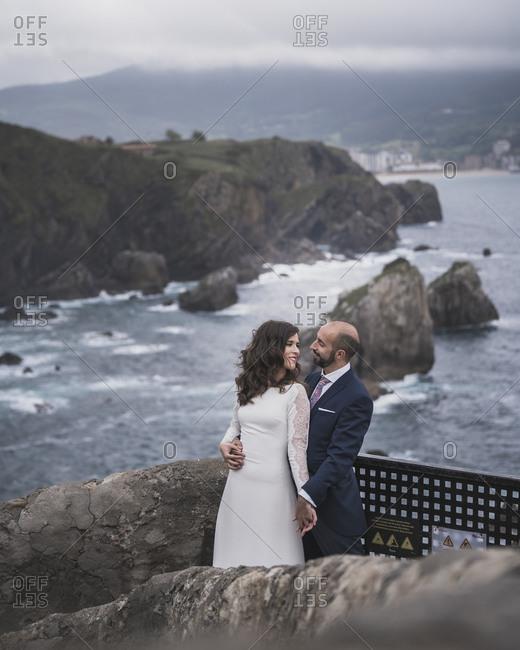 Bridal couple on bridge- Gaztelugatxe- Spain