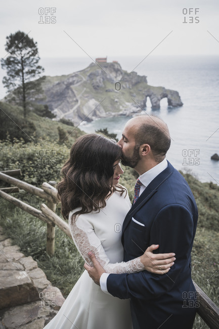 Bridal couple on bridge- Gaztelugatxe- Spain
