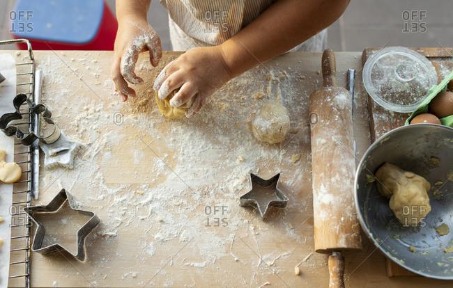 Crop view of boy kneading dough