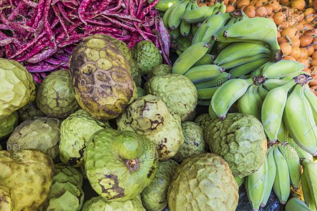 Portugal- Madeira- Funchal- Cherimoya (Annona cherimola) and bananas at farmers market