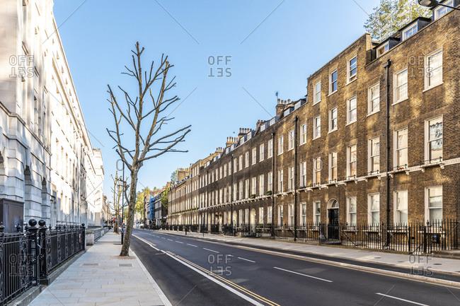 UK- London- Brick buildings in empty street during curfew in Bloomsbury neighborhood