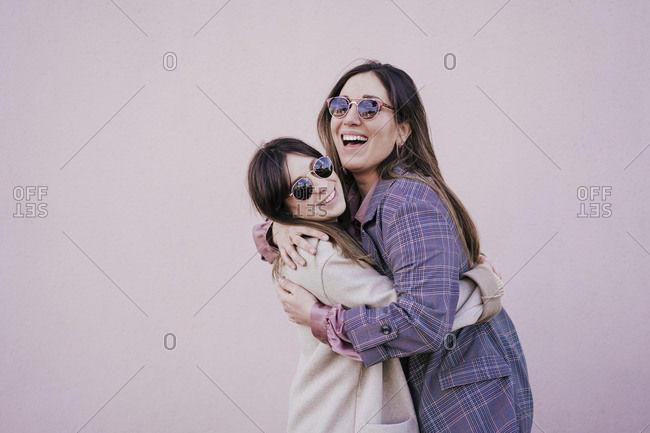 Portrait of two happy young women hugging each other