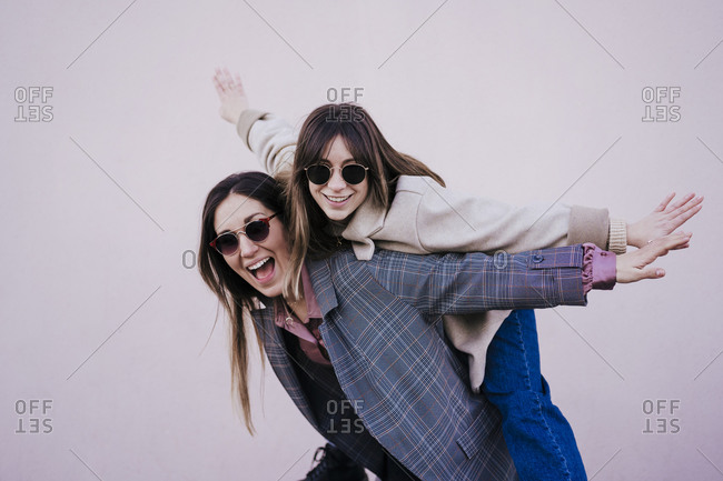Portrait of two happy women having fun together