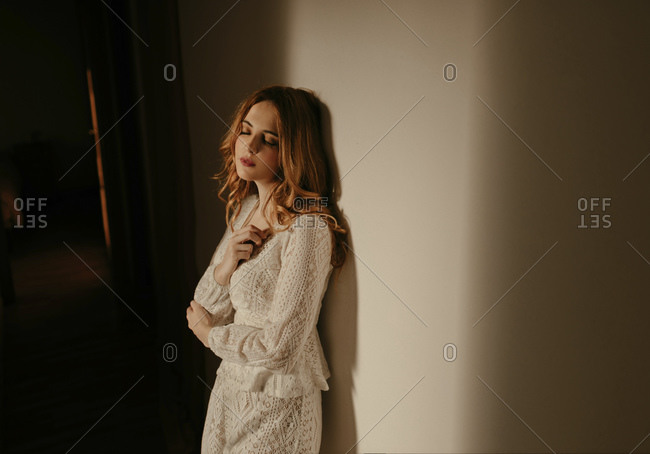 Blond woman at home in pajama