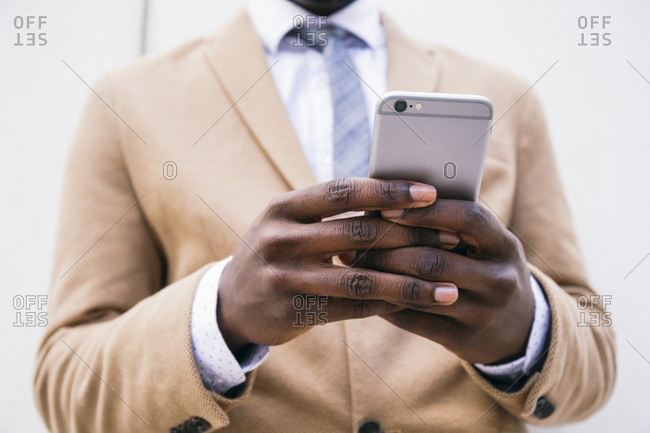 Hands of a businessman using smartphone