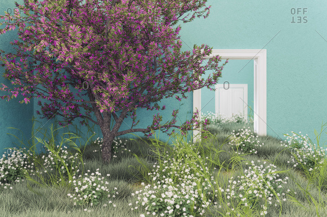 Flowering tree and meadow growing in rooms of empty house