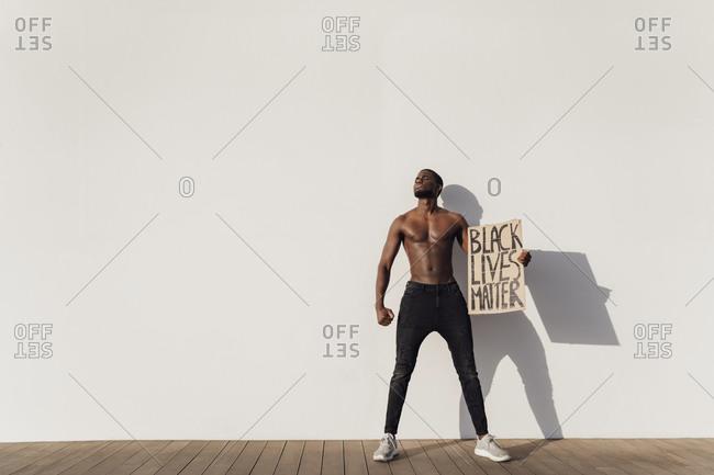 Black man holding Black Lives Matter sign