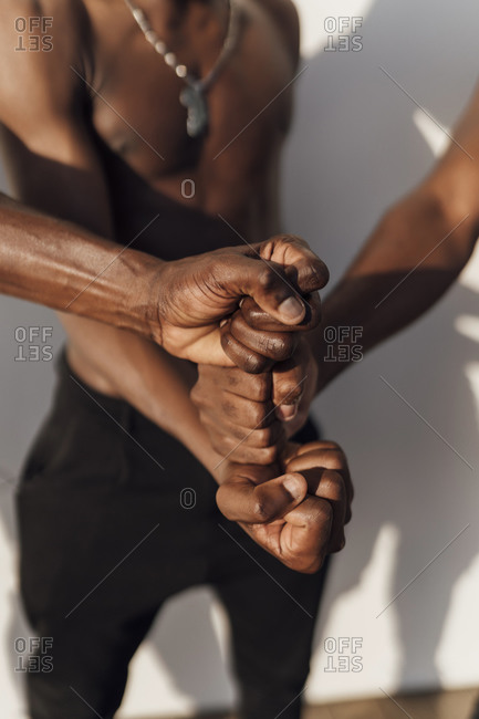 Friends stacking fists in the middle