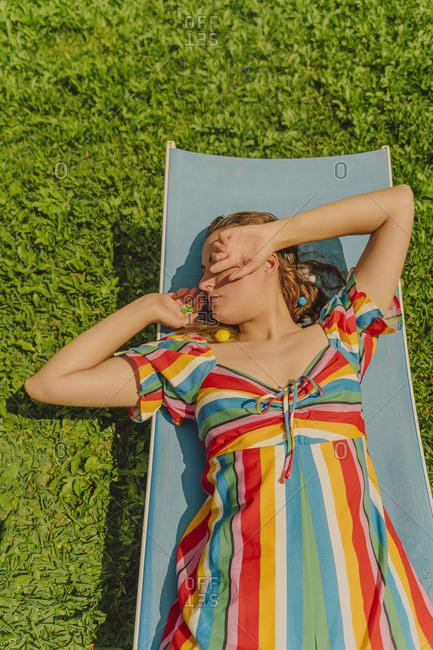 Woman relaxing on sun lounger