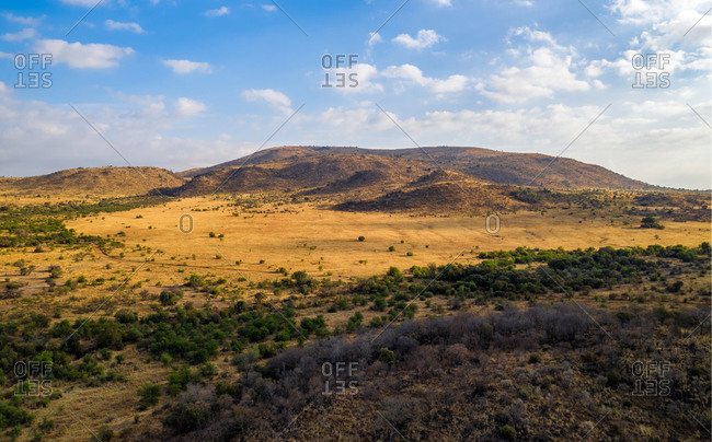 Panoramic aerial view of mountains on sunny day in Pilanesberg National Park, South Africa