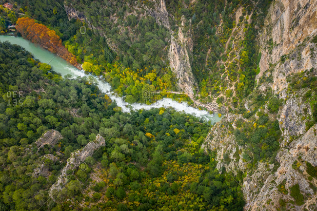 Panoramic aerial view of a river surrounded by trees in Fontaine de Vaucluse, France