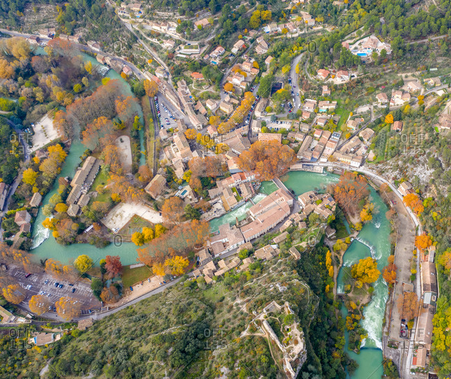 Aerial view of a houses around a water channel in Fontaine de Vaucluse, France