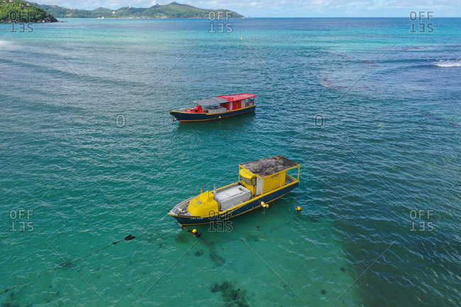 May 22, 2020: Aerial view of a pair of fishing boats anchored in Anse a la Mouchel, MahE, Seychelles